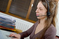 Helpline female customer support operator with headset and smiling Stock Photography