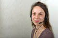 Helpline female customer support operator with headset and smiling Royalty Free Stock Images