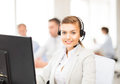 Helpline operator with headphones in call centre Royalty Free Stock Photo