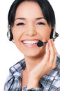 Helpline operator smiling female with headphones giving a consultation Royalty Free Stock Images