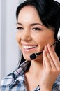 Helpline operator smiling female with headphones giving a consultation Stock Photo