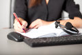 Helpline operator writing notes Royalty Free Stock Photos