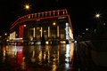 Helsinki christmas night time rainy reflections of the landmark stockmann superstore in finland Royalty Free Stock Image