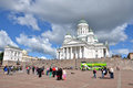 HELSINKI / FINLAND - July 20, 2013: White Helsinki Cathedral, the evangelical lutheran church. At the picture are many people and Royalty Free Stock Photo