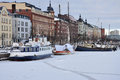 Helsinki old harbour and ships in winter scene of frozen port finland Stock Photo