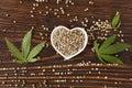 Hemp seeds on wooden background. Royalty Free Stock Photo