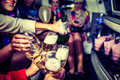 Hen party with champagne girls in limo at Stock Images