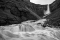 Hengifoss black white motion blurred wild stream below waterfall Royalty Free Stock Photo