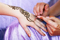 Henna applying image detail of being applied to hand Royalty Free Stock Photography