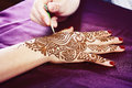Henna being applied image detail of to hand close up Royalty Free Stock Image