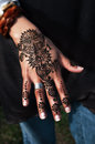 Henna tatto on woman's hand trendy floral design Royalty Free Stock Photo