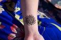 Henna tattoo mehendy on hand mandala Royalty Free Stock Photo
