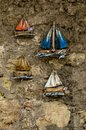 HERAKLION, GREECE - November, 2017: Wooden toy boats under multi Royalty Free Stock Photo