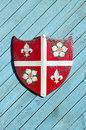 Heraldic knights shield on wooden background Stock Images