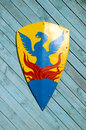 Heraldic knights shield on wooden background Stock Photography