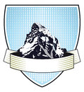 Heraldic mountain crest blue or coat of arms with an illustration of an alpine Stock Images