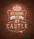 Heraldic sign on brick wall my home is my castle sayings lettering painted with white paint vintage Stock Photography