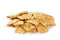 Herb seasoned crackers a mound of on a white background Stock Photos