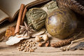 Herb and spice many with old reference book Royalty Free Stock Photo
