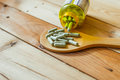 Herbal in capsule on wood table Royalty Free Stock Photo