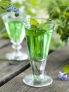 Herbal liquor in glass selective focus Royalty Free Stock Photo