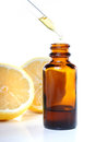 Herbal medicine dropper bottle with lemons Royalty Free Stock Photo