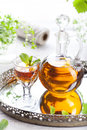 Herbal, mint homemade liquor. Russian traditional strong spirits Royalty Free Stock Photo