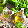Herbal oil against a wooden background Stock Photos