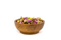 Herbal rose tea in a wooden bowl isolated on white Royalty Free Stock Photo