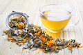 Herbal tea with calendula hot cup of and dry herbals Stock Photo