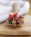 Herbal tea from the dried flower buds of roses in a wooden spoon Stock Image
