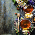 Herbal tea with honey wild berry and flowers on wooden background Royalty Free Stock Image