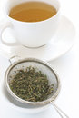 Herbal tea making with leave in a sieve Stock Image