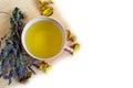 Herbal tea in red cup, dry marjoram herbs on Royalty Free Stock Photo