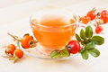 Herbal tea and rose hips pink in glass cup fruits Stock Images