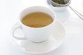 Herbal tea in a white china cup Stock Photography
