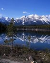 Herbert lake alberta canada view across towards snow capped mountains and forest banff national park Stock Photo