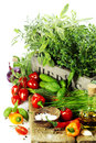 Herbs in the box and fresh vegetables Stock Photos