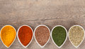Herbs and spices border colourful ground or dried with copy space above includes turmeric cayenne pepper dill flax seed fennel Royalty Free Stock Photography