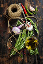 Herbs and spices bunch of fresh rosemary sult pepper olive oil on old wooden table Stock Photo