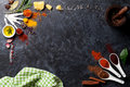 Herbs and spices over black stone background top view with copy space Stock Photos