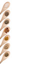 Herbs and spices on wood spoons isolated on a white background Stock Photography