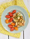 Herby tofu scramble bruschetta with and grilled cherry tomatoes Royalty Free Stock Images