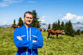 Herdsman and cows standing in front of in alpine mountains Stock Photos
