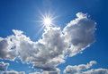 Here comes the sun image of a sky witk shining through heavy clouds Royalty Free Stock Photo