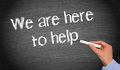"""Here to help customer care concept with the message """"we are help"""" written in chalk on a blackboard Royalty Free Stock Photos"""