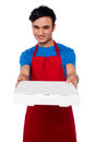 Here is your order sir young male chef delivering the Stock Photography