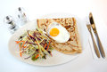 Here is a yummy brunch for you fried eggs with coleslaw served delicious Royalty Free Stock Photography