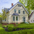 Heritage home beautiful with a lovely green front yard in spring Stock Photos