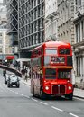 Heritage Routemaster Bus operating in a busy Central London street with traditional black cab on background